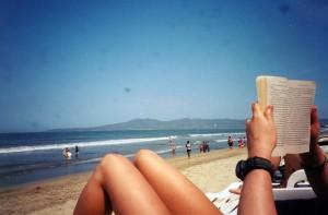 Tash reading on the beach